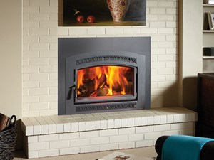 A Lopi Large Flush Wood Hybrid-Fyre™ Arched Fireplace Insert features Modern clean burning technology. Available at The Energy House in Northern California.